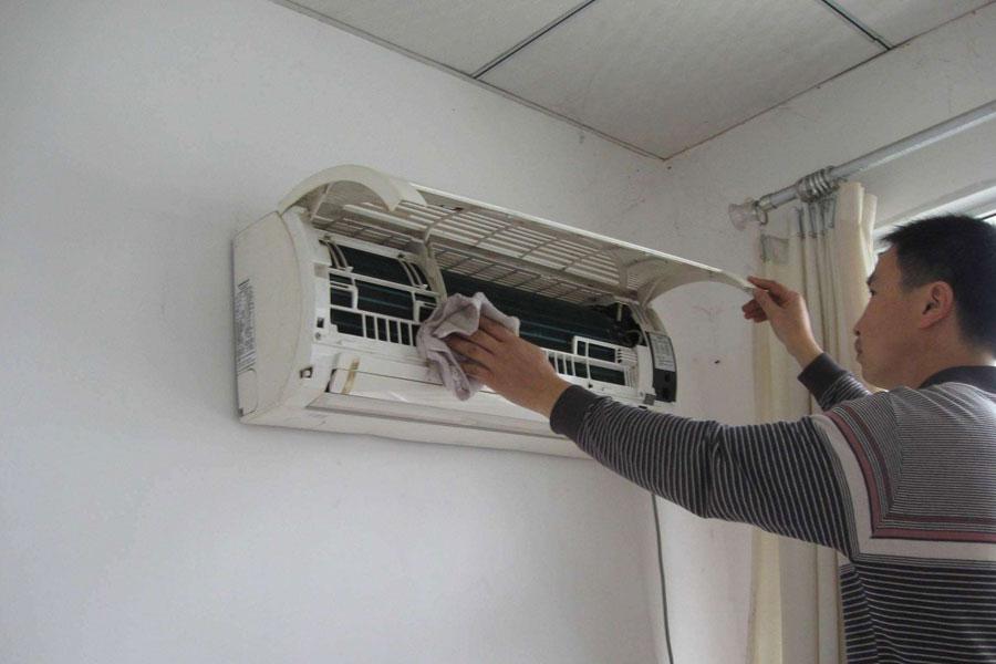 北京搬家公司告诉您清理空调的小技巧